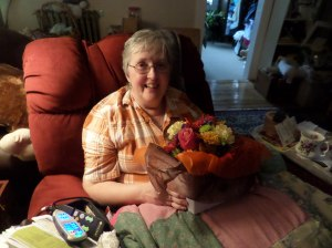 Mary enjoying her birthday flowers