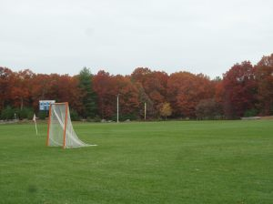 Bright oak foliage rings the athletic fields at Medway High school